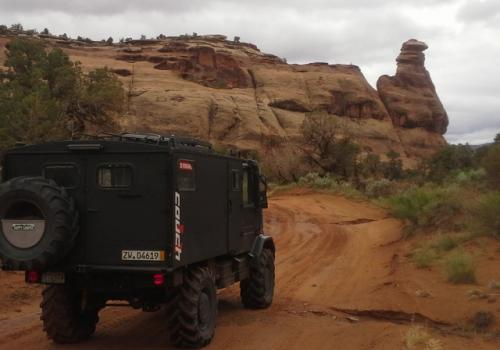 Unimog 140 Darth Mog on trail in Moab