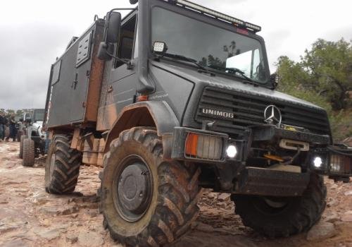 Unimog 140 Darth Mog getting muddy in Moab