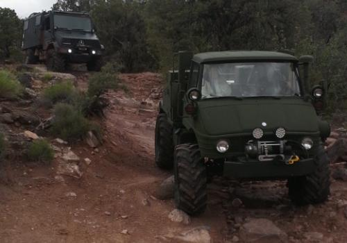 See tractor and Unimog 140 on trail in Moab