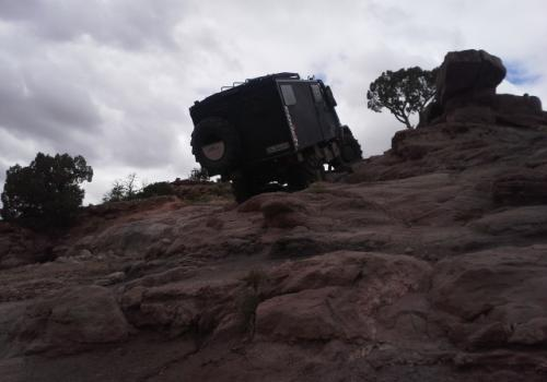 Unimog 140 crawling up the rocks in Moab