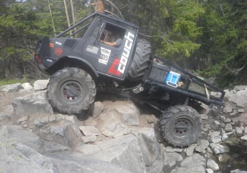 Unimog 1700 BAM BAM crawling up the rocks on Holy Cross 4x4 Trail