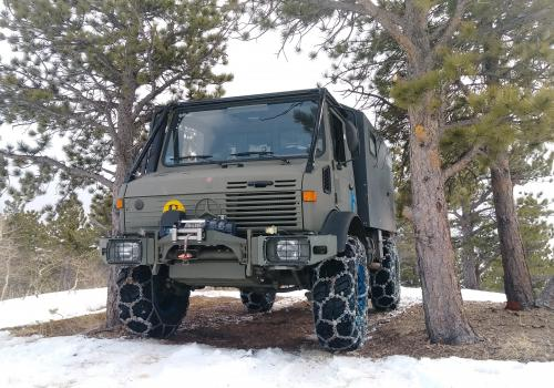 Mercedes Unimog 1350 all chained up on a trail in Colorado