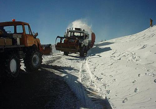 Unimog clearing roads snow blowing