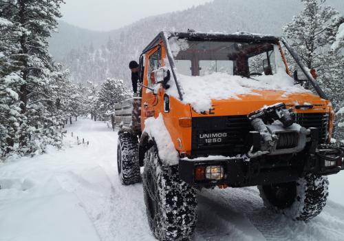 Unimog 1250 four wheeling in the snow with snow chains